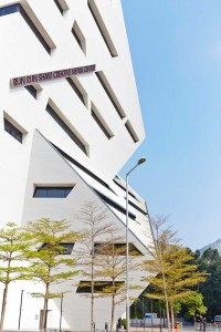 white angular architecture with green trees by airey spaces