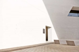 door way in white wall of libeskind building hong kong by airey spaces