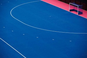 white lines markings and goal on pink and blue hockey pitch at london olympics by airey spaces