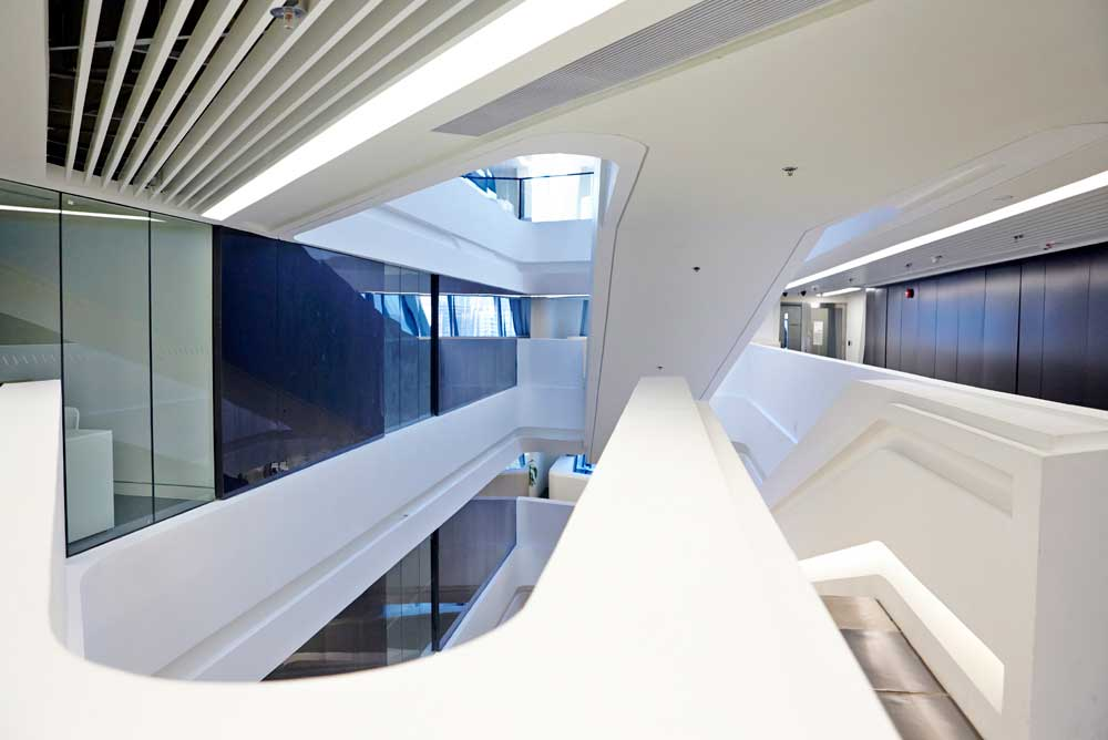 white interior of college with black and glass walls by airey spaces