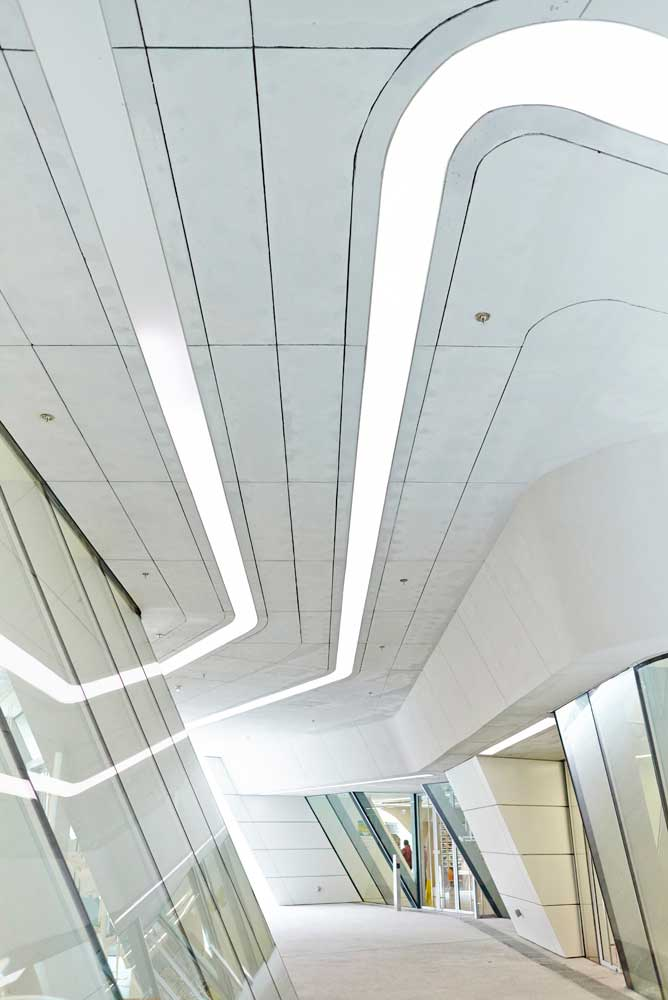 curve of lighting installation and glass walls by airey spaces