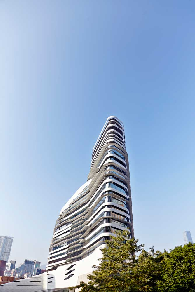 whole innovation tower and blue sky from below by airey spaces
