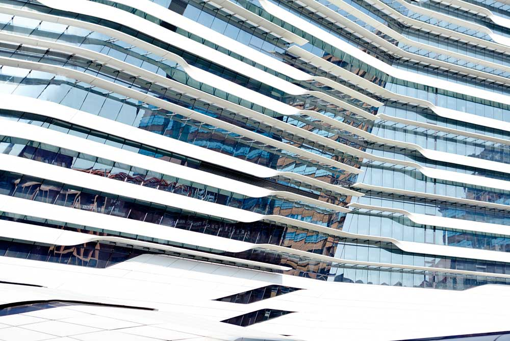 blue glass and white stripes of innovation tower by airey spaces