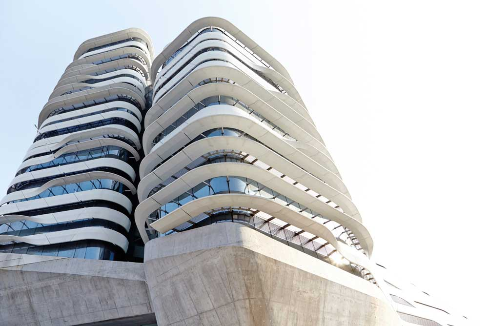 looking up at white stripes of architecture by airey spaces