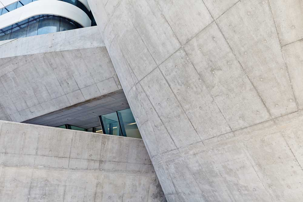 grey concrete structure of innovation tower by airey spaces