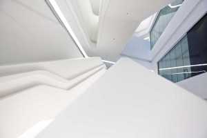 perspective view of all white staircase and atrium of innovation tower by airey spaces