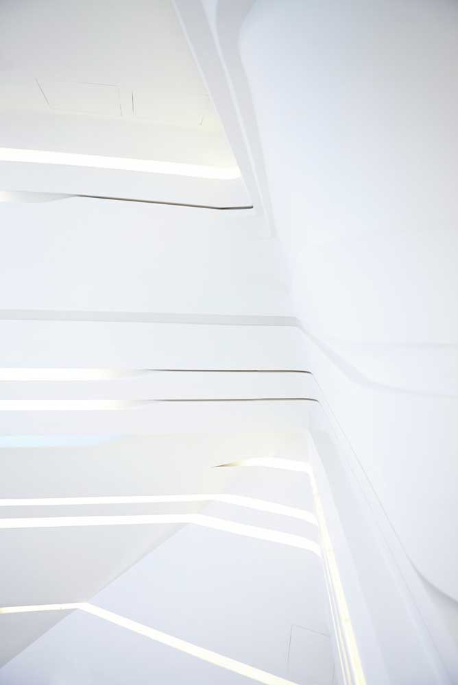 abstract white walls and lighting inside innovation tower by airey spaces