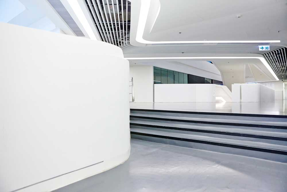 white walls and graphic lines of college space inside innovation tower by airey spaces