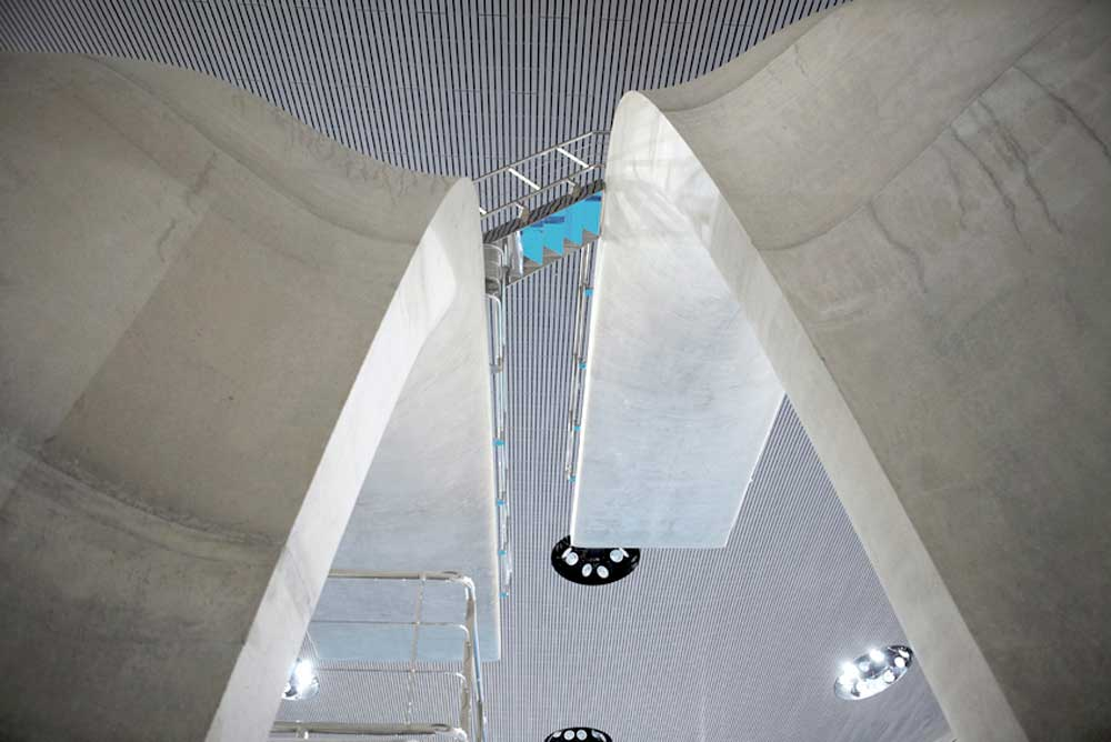 large concrete diving boards at london aquatic centre by airey spaces
