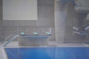 turquoise diving boards and swimming pool at london aquatic centre by airey spaces