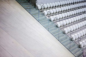 rows of empty seats and stairs at london aquatic centre by airey spaces