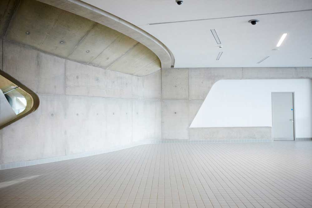 concrete and tile white entrance to aquatic centre by airey spaces
