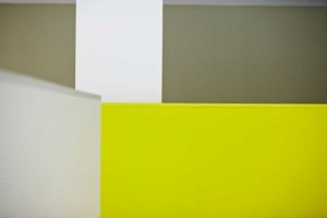 abstract geometrical luminous green and olive green walls in london office by airey spaces