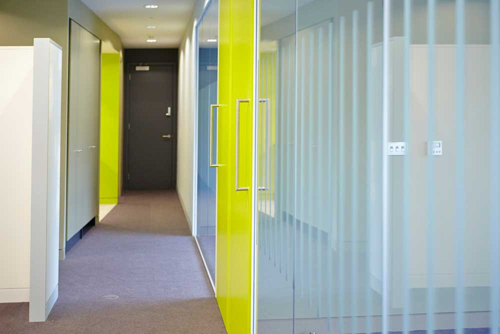 modern london offices with glass room and luminous green doors by airey spaces