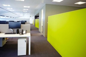 open plan london office space with luminous green wall by airey spaces