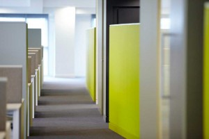 modern office area with luminous green wall by airey spaces