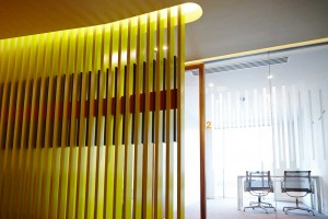 modern yellow striped wall with daylight white meeting room in london office by airey spaces