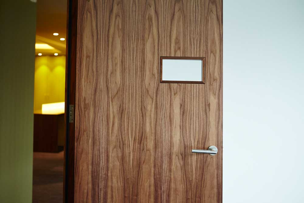 wooden door in modern office with window by airey spaces