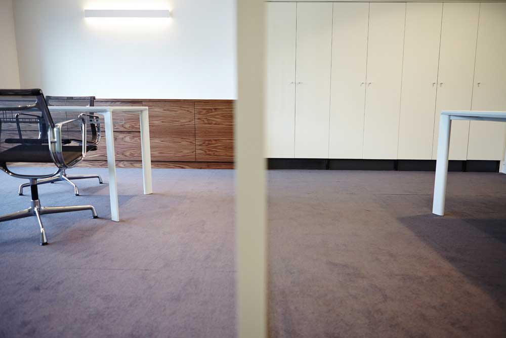two rooms with dividing wall in modern london office space by airey spaces