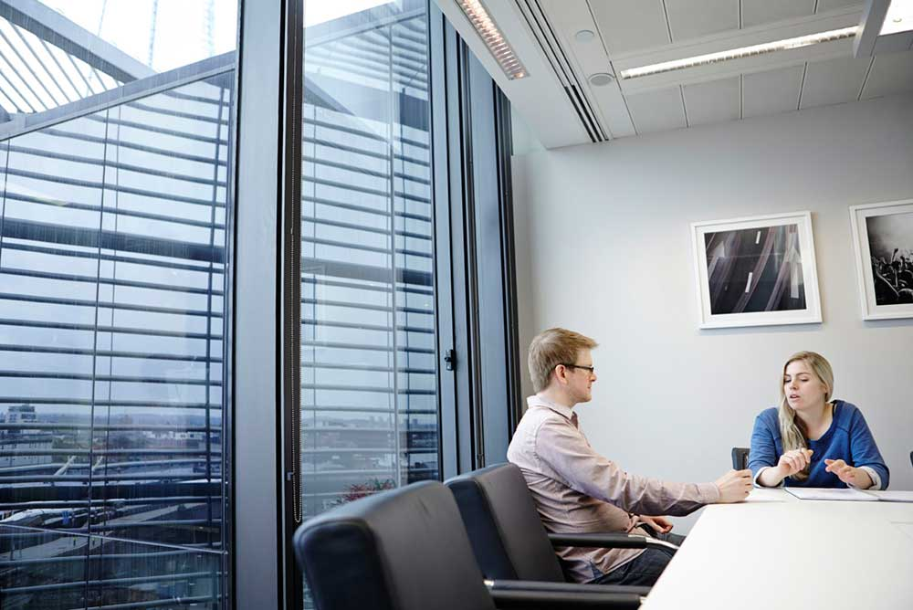 2 people in light meeting room of london office by airey spaces