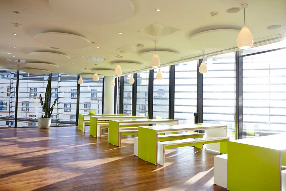 office breakout area with green furniture in sunlight by airey spaces