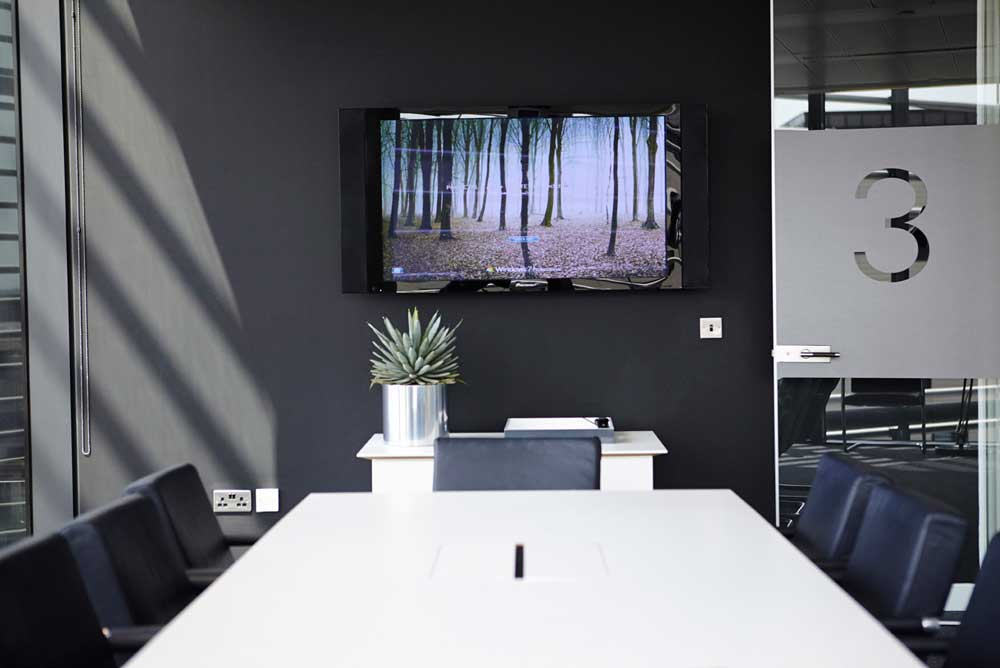 black wall meeting room with display screen in stylish london offices by airey spaces