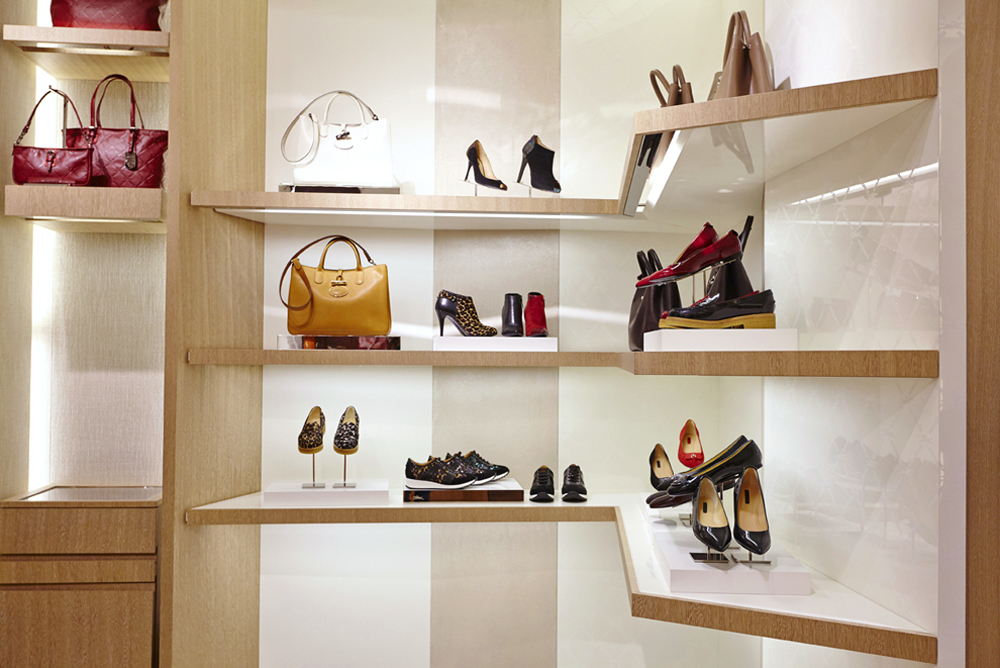 shelving detail with shoes for new longchamp store by airey spaces