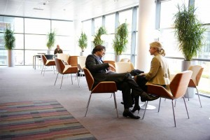 couple business meeting in office reception area by airey spaces