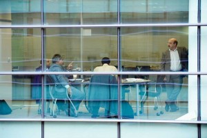 business meeting in glass office from outside by airey spaces
