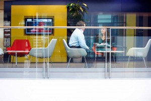 yellow blue and red office space with man and woman meeting by airey spaces