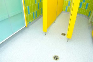 swimming pool shower cubicles yellow by airey spaces