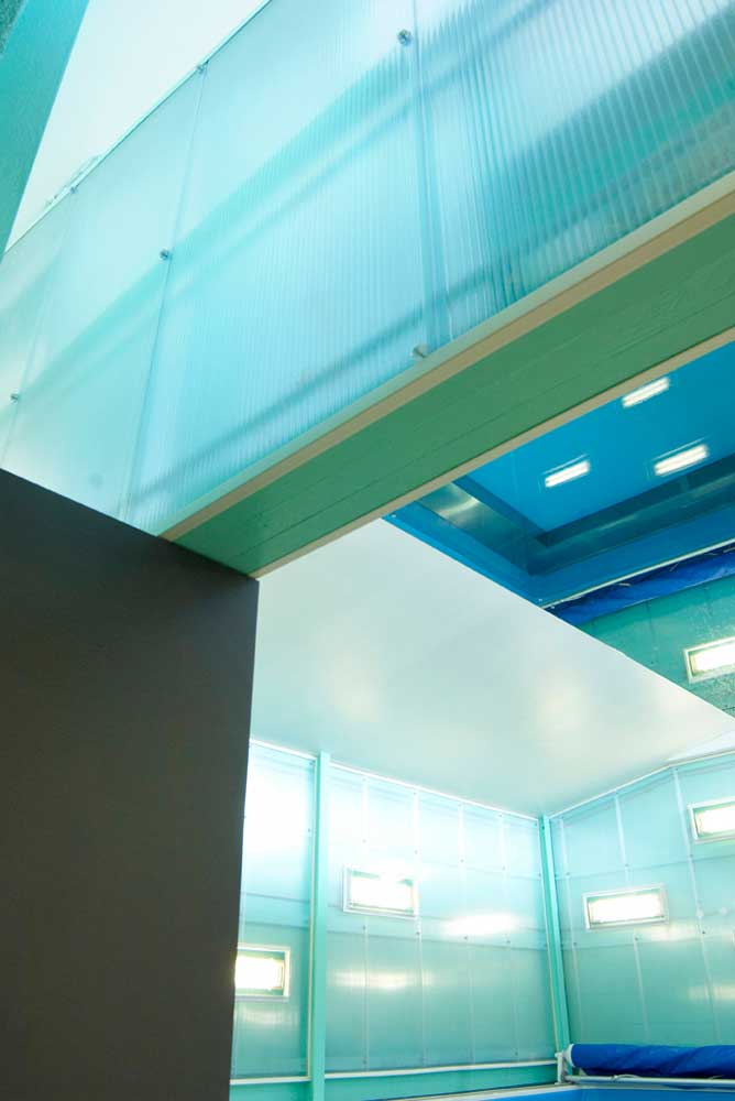 turquoise blue abstract interior of swimming pool centre by airey spaces