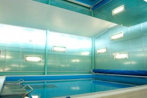current swimming pool and turquoise wall in swim centre by airey spaces