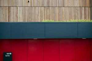building for tennis at Eton Manor red and wood by airey spaces