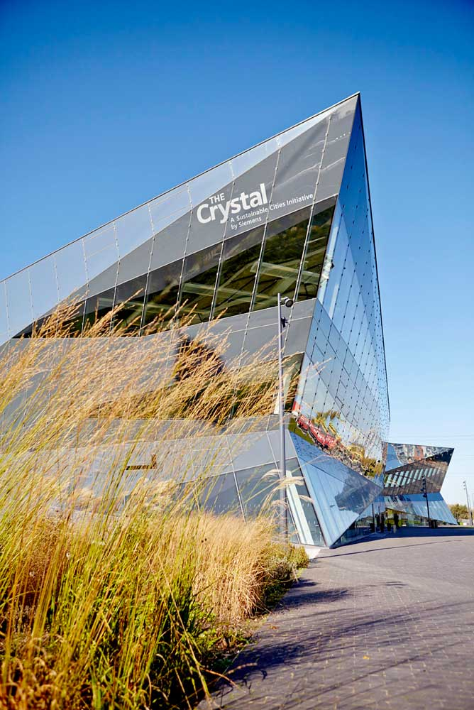 glass exterior with grasses and blue sky at the london crystal by airey spaces