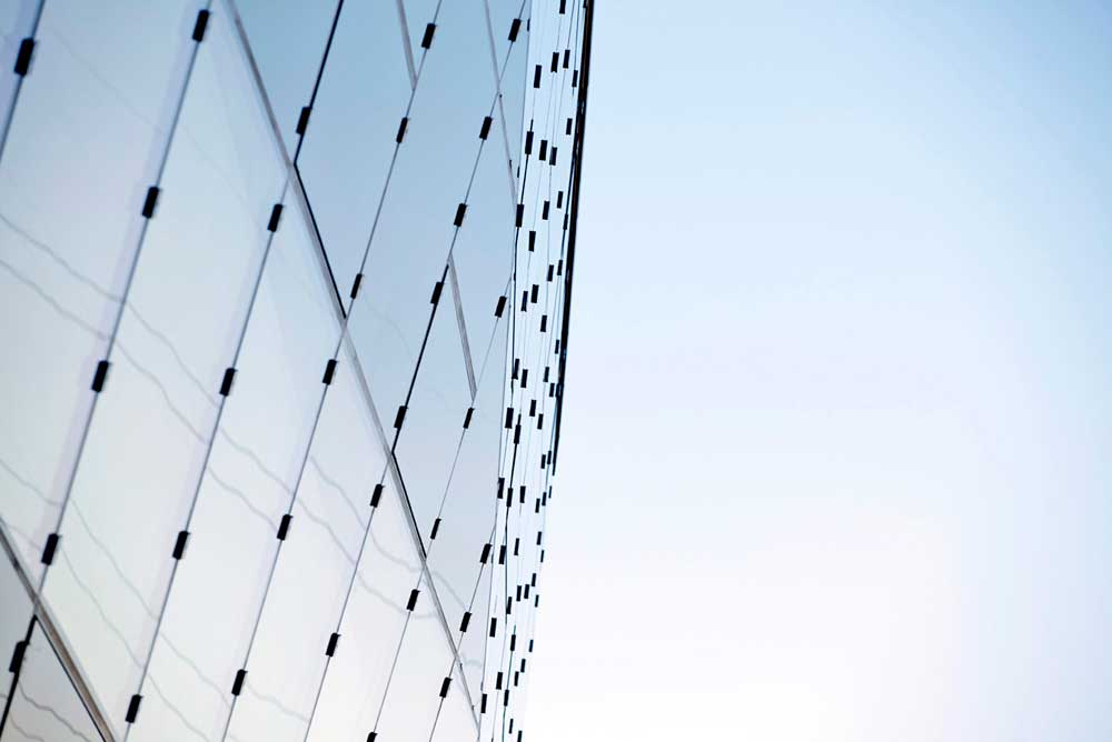 glass exterior with blue sky at the london crystal by airey spaces