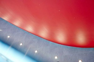 the red auditorium inside the crystal london by airey spaces
