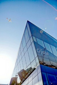 glass exterior and aeroplane with blue sky at the london crystal by airey spaces