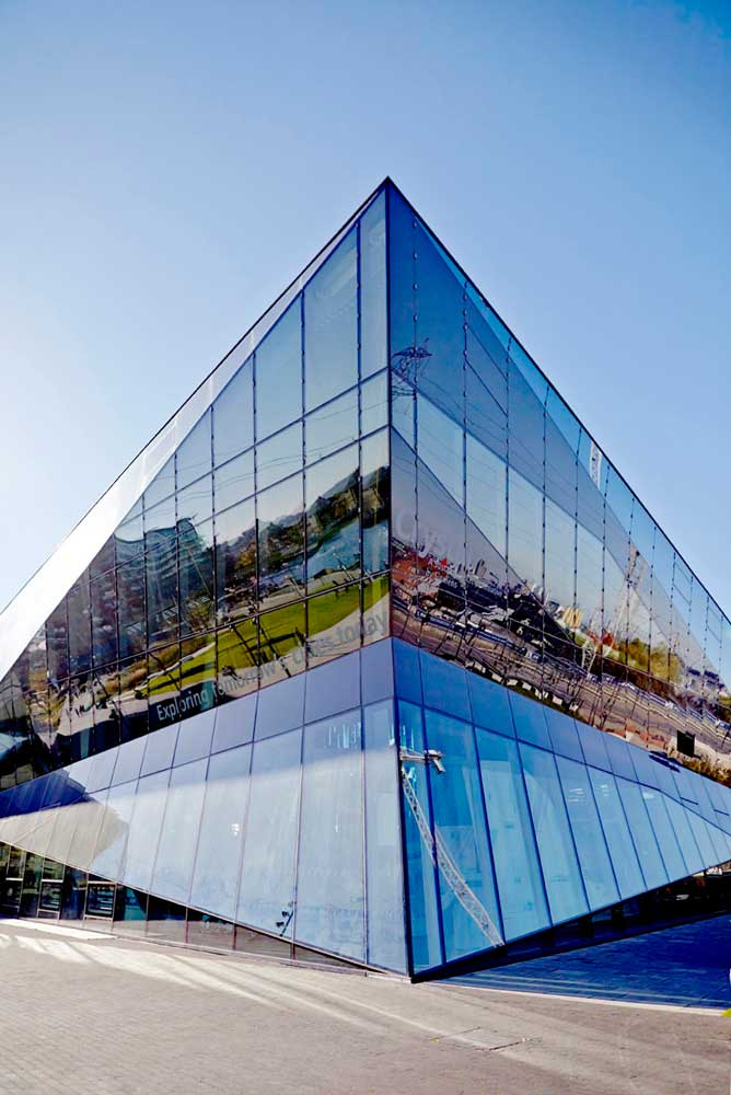 diamond shape glass exterior with blue sky at the london crystal by airey spaces