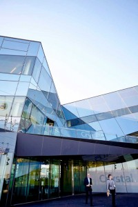 glass exterior with people and blue sky at the london crystal by airey spaces