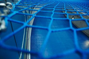 blue netting over velodrome at London 2012 Olympic arena by airey spaces