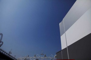 exterior stripes and blue sky of water polo arena next to stadium at London 2012 olympics by airey spaces
