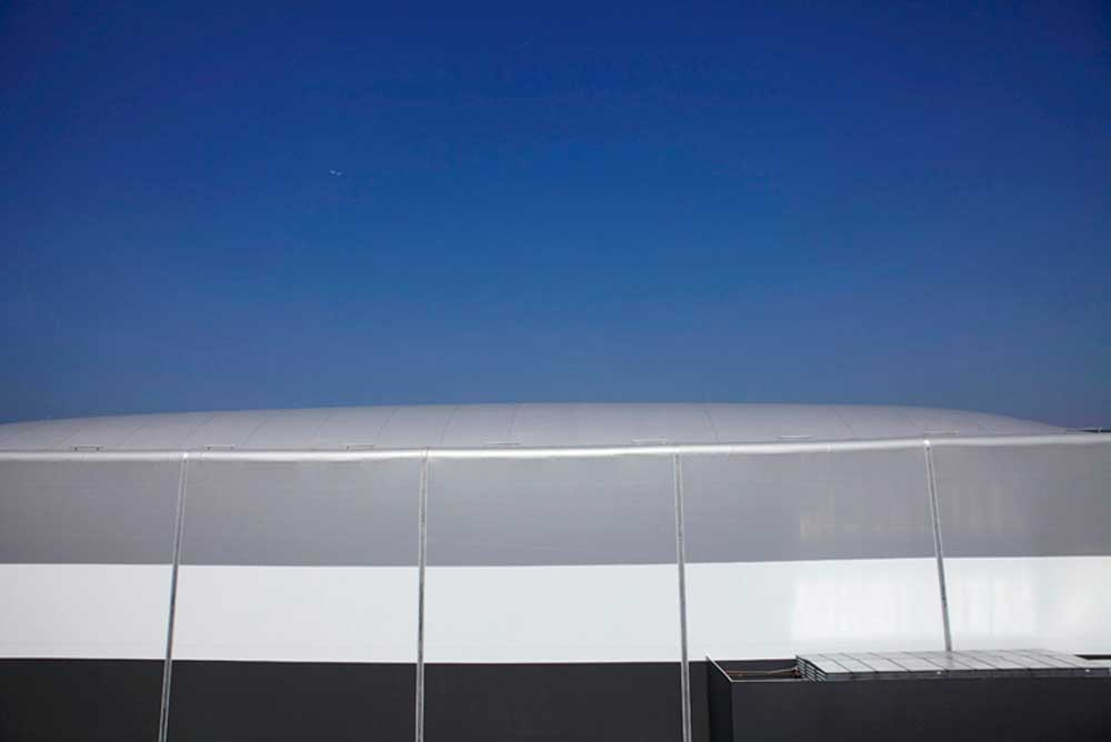 exterior stripes and blue sky of water polo arena at London 2012 olympics by airey spaces