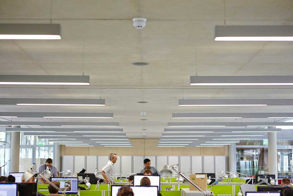 the living planet centre office space with green desks in WWF building by Airey Spaces