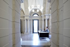 man at reception desk in tate britain reception area by airey spaces