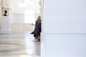 woman talking in tate britain cafe with sculpture bust by airey spaces