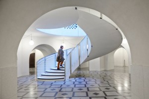 man on spiral staircase in tate britain by airey spaces