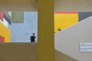 people on stair case and artwork in tate britain entrance by airey spaces