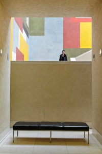 staircase through window of tate britain with bench and artwork by airey spaces