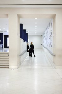 women talking in hallway tate britain interior by airey spaces